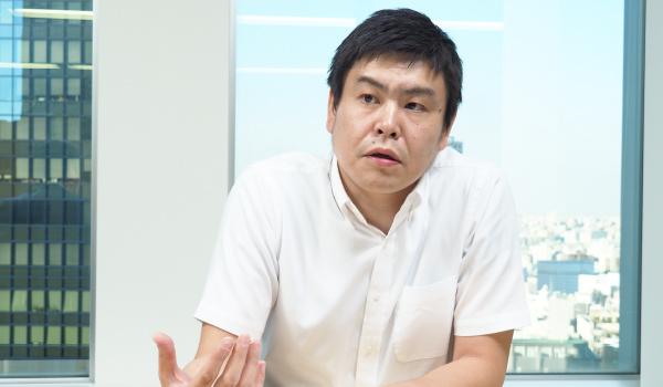 執行役員 システムソリューション部 部長 鈴木 弥一郎氏